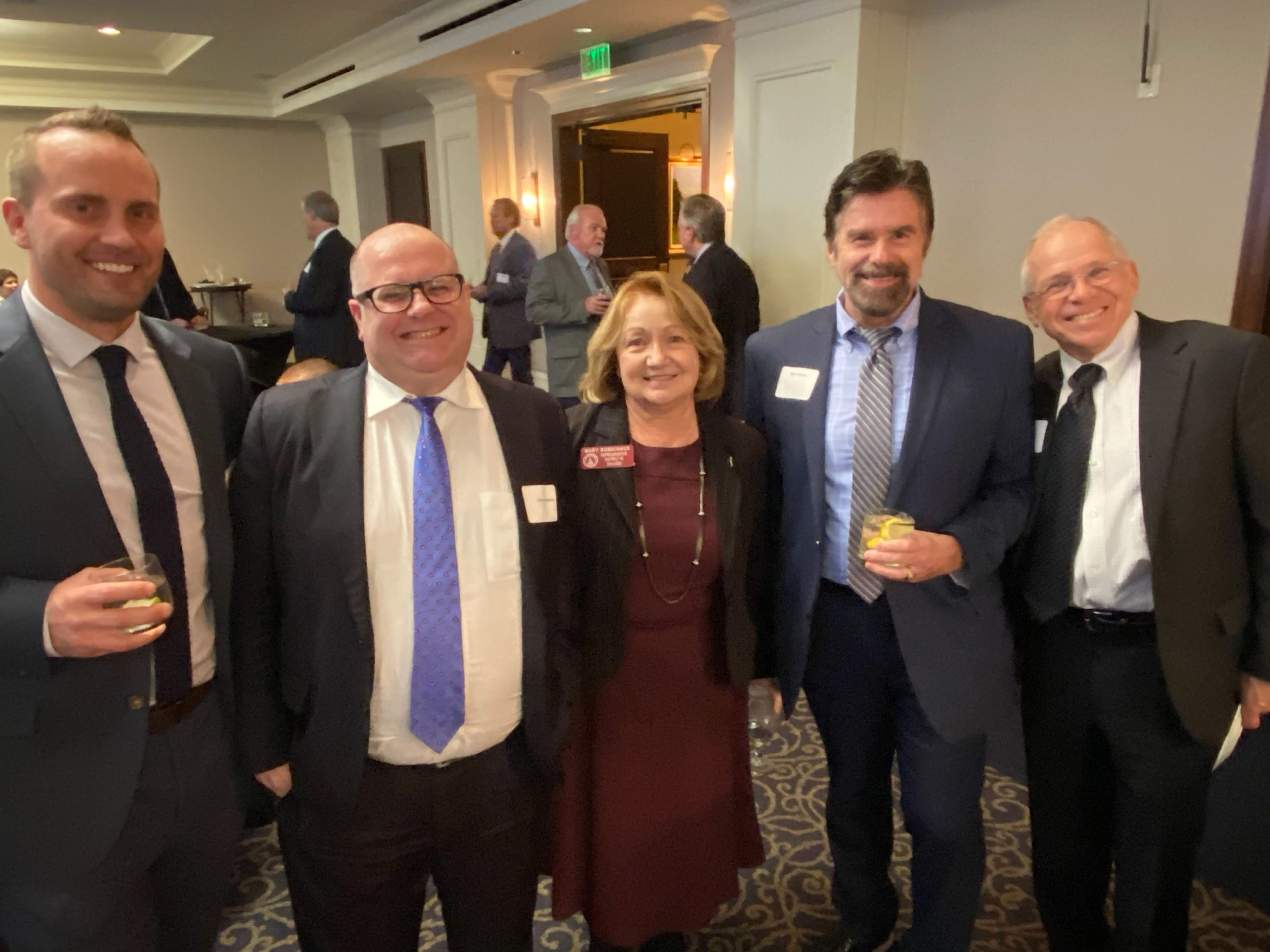 Robbie Jones of Coastal Electric, Chris Caiaccio of Kilpatrick Townsend, Senator Mary Robichaux, Niel Dawson and Tom Lemay of Metropower.